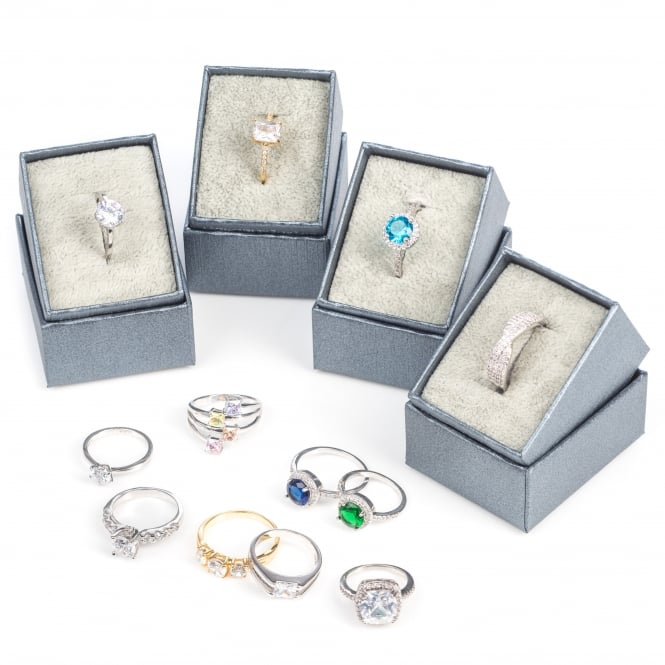 Sale Pack OF 12 Assorted fixed size cubic zirconia dress rings .Only £3.25 for each ring.