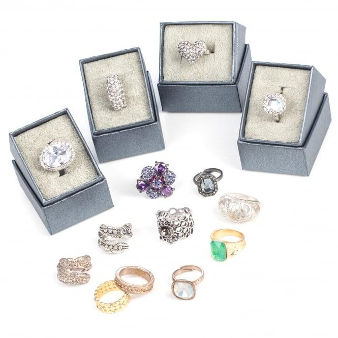 12 Assorted adjustable and fixed size fashion rings with boxes.Only £2.50 each.